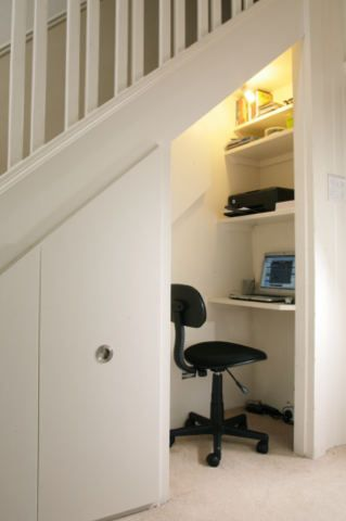 under stairs storage with study nook or home office.  Storage under stairs can hold crafts supplies.