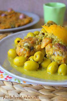 Tajine de poulet aux citrons confits et olives vertes recette marocaine .