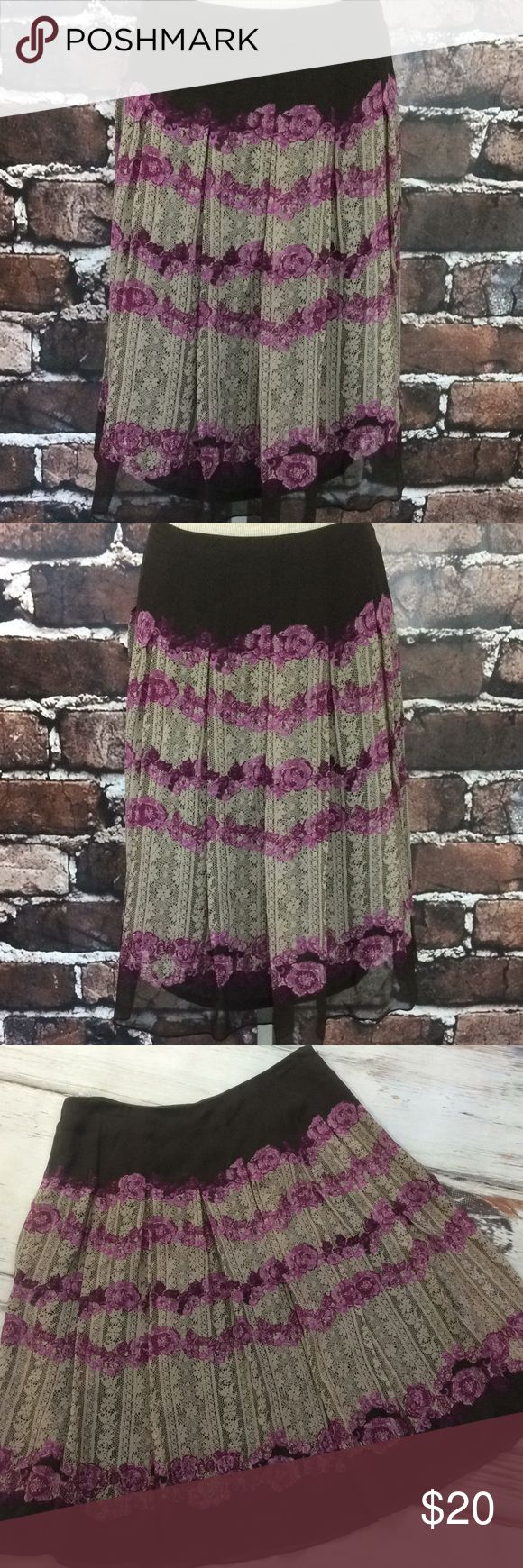 "Anne Klein brown purple floral pleated silk skirt Gorgeous skirt. Flowing with pleats. Brown with pinky purple magenta flowers and cream lace design. Anne Klein. Women's skirt size 4. Full and pleated. 100% silk. Lined. Waist 29"" Length 24.5"" Anne Klein Skirts A-Line or Full"
