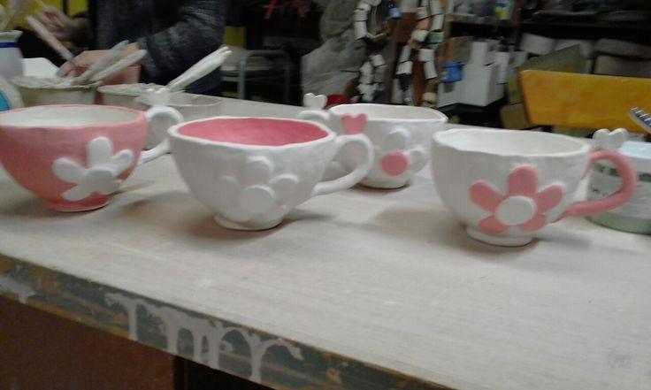4 teacups getting painted