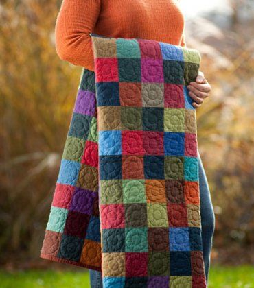 Love the simplicity of this and the bright jewel tones. The circular quilting makes it really special.
