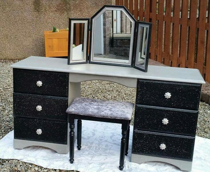 This was an old boring pine dressing table which I painted in grey chalk last paint and black for drawer fronts.then I sealed it with a varnish that I added some chunky glitter..I then changed the handles for these lovely grey ones with silver detailing..I also painted the stool In a black matt paint and glittered it too..I recovered the stool in this lovely silver grey to coordinate with the rest.