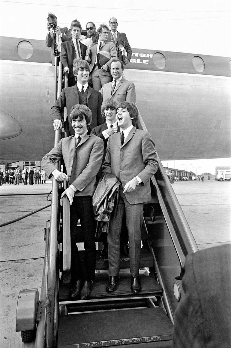 The Beatles in Liverpool for the Premier of a Hard Day's Night. John Lennon, George Harrison, Paul McCartney and Ringo Starr pictured on the stair of the Plane in Liverpool as they arrive for the premier of A Hard Day's Night. 12th July 1964.