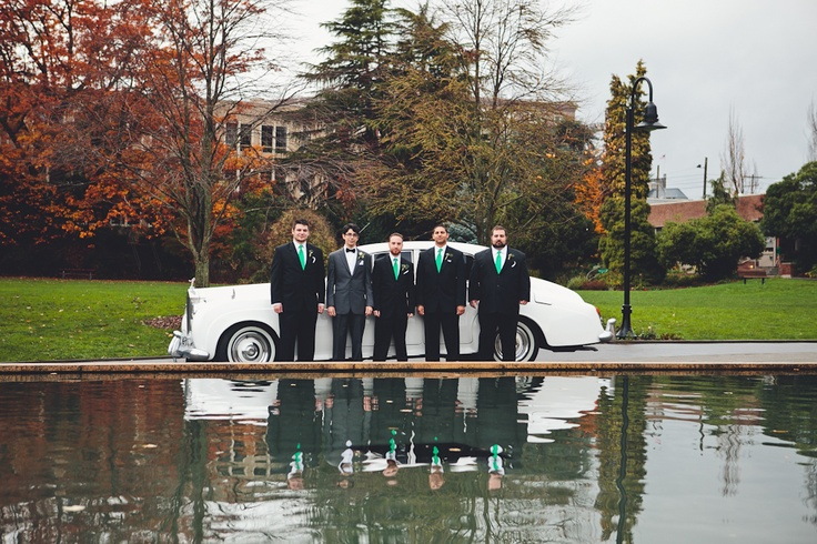 Groom with groomsmen on Seattle University campus. Suits from The Tux Shop. 1965 Rolls Royce from British Motor Coach.