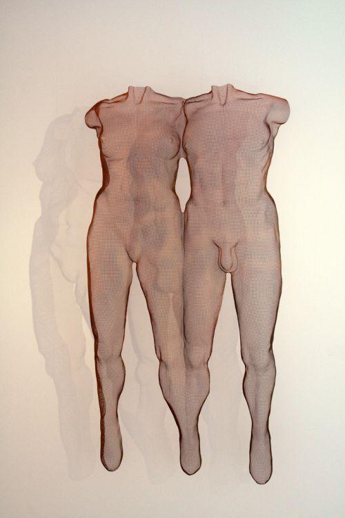 Steelmesh Allegorical sculpture by #sculptor David Begbie titled: 'NUUDIS 2011 (Nude Couples Wire Mesh Wall statue)' #sculpture #art