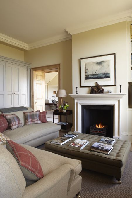 Walls in Farrow & Ball's String with ceiling in Pointing.. also love the coffee table and cushions