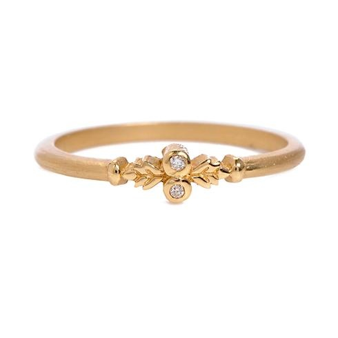 """The perfect match for Megan Thorne's delightfully detailed engagement rings, this """"Wood Nymph"""" wedding band features satin-finish yellow gold decorated with petite diamonds and engraved flourishes.  Megan Thorne at Greenwich Jewelers, $500"""