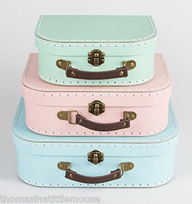 THESE LOVELY cardboard SUITCASES are a set of 3 1 x Pink and 1 x Duck Egg Blue 1 x Pale Mint Great for storage of those toys with lots of little