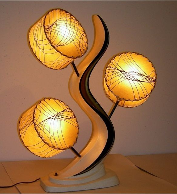 Oh my...love the form, the shades, the lines....ahhh. just a quintessential mid century modern lamp.  http://www.flickr.com/photos/kittysvintagekitsch/