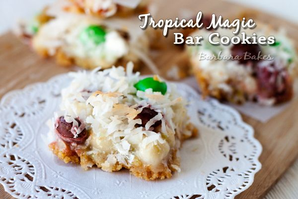 Tropical Magic Bars :: Like a Hello Dolly/Magic Cookie Bar with lime zest, macadamia nuts and coconut m's! via Barbara Bakes