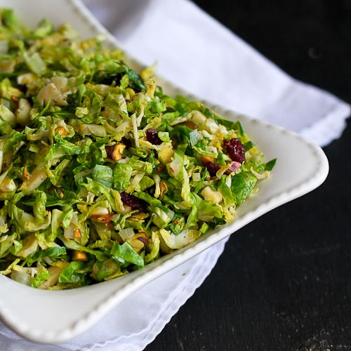 Shredded Brussels sprouts are an easy side dish for Thanksgiving. Pistachios, dried cranberries and salty Parmesan cheese add a burst of flavor and texture.