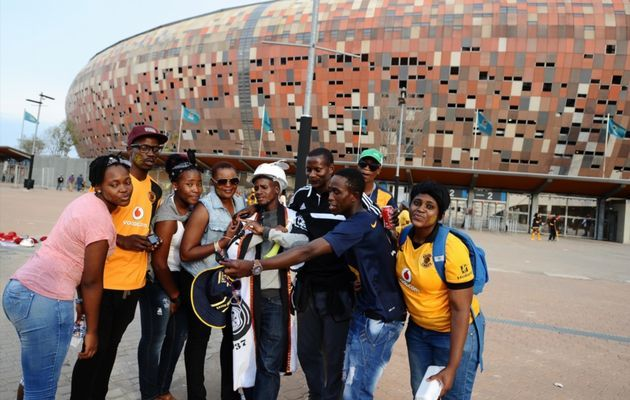 Fans and Helman Mkhalele during the Absa Premiership match between Orlando Pirates and Kaizer Chiefs at FNB Stadium on December 06, 2014 in Johannesburg, South Africa.  Image by: Lefty Shivambu/Gallo Images