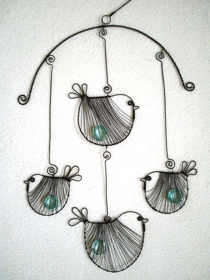 Birds curtain made of black annealed wire, which is decorated with glass pellets. The length is about 45 cm and a width of about 25 cm. The size of large birds is about 10x9cm and small is about 8x7cm.