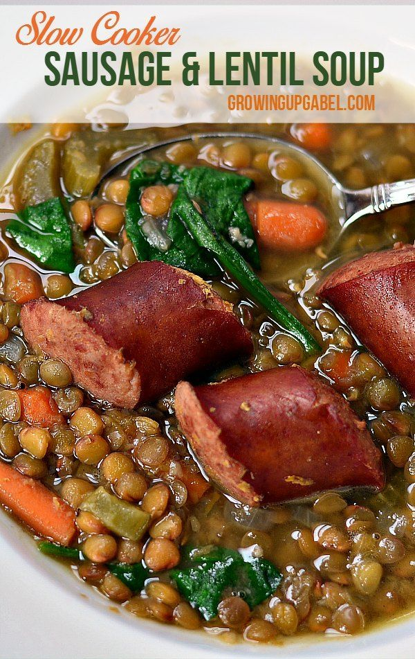 Sausage and lentil soup is cooked in Crock Pot slow cooker until the lentils are tender in this delicious comfort food. Baby spinach and carrots are added for a healthy one pot meal.