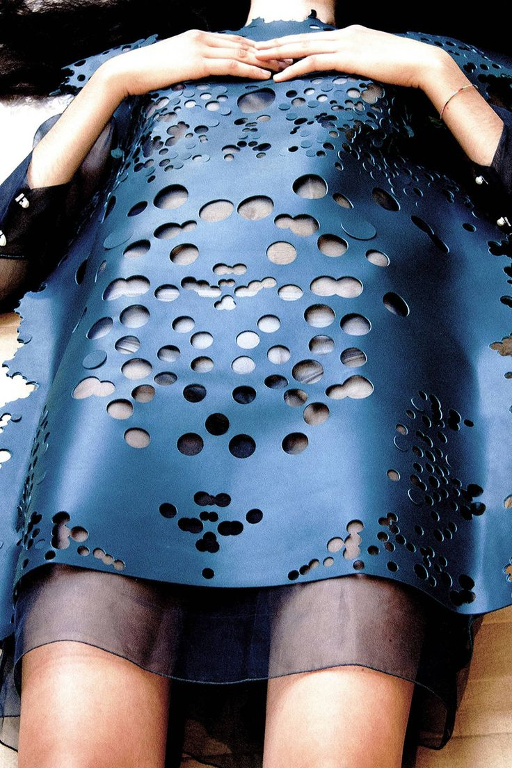 Dmitry Bukreev ph. Dmitry Bukreev ph. Perforated cut out hole punched rubber latex fashion piece photography.