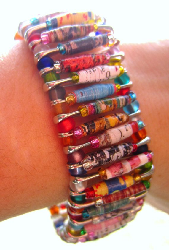 Combines the idea of paper beads with the safety pin bracelet