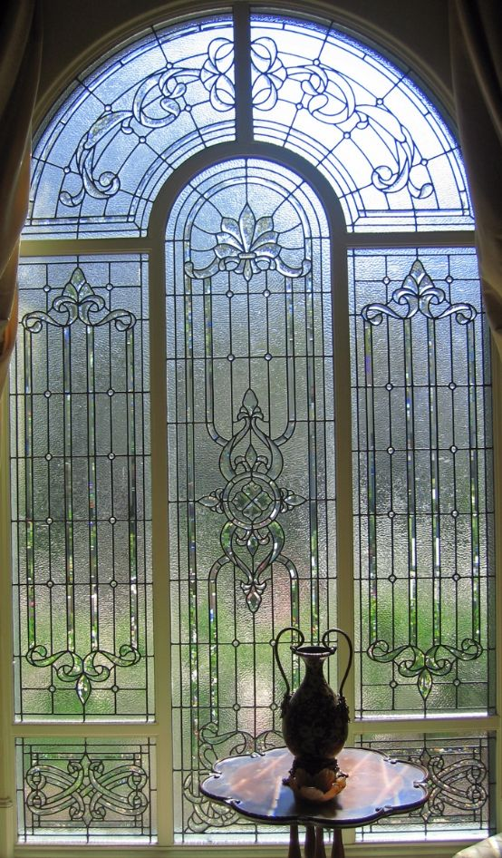 Leaded glass window using clear textures with the combination of clear beveled glass creates a striking contrast and levels of visual textures that change with the natural light source.