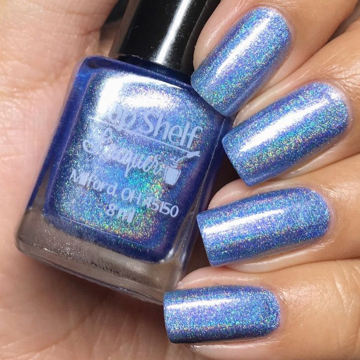 Top Shelf Lacquer - Blue Kamikaze: Is a cornflower blue linear holo with a hint of pink shimmer