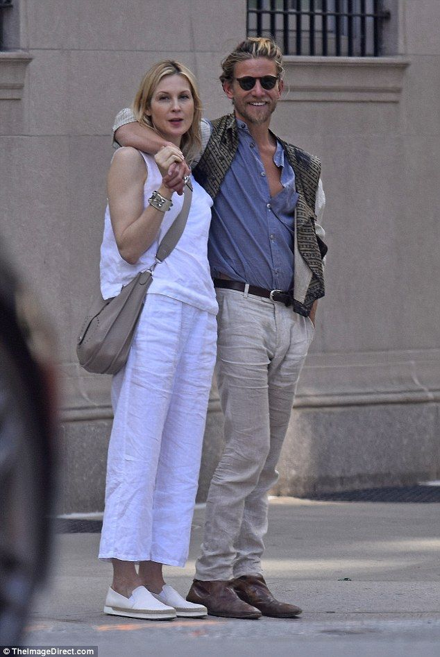 New couple alert! Kelly Rutherford certainly looked delighted with her new man Jeff Garner on Thursday