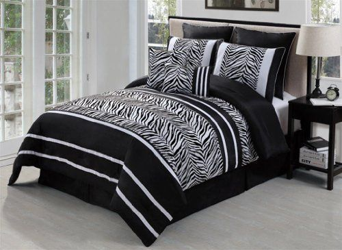 """Laken Zebra Black / White King 8 Piece Comforter Bed In A Bag Set by Victoria Classics. $79.99. Sleep in Style, with the Laken 8-piece Comforter Set. This comforter set will enhance your décor with its sleek stripes and fabulous colors. The zebra flocking brings a rich look to the comforter set. One King Comforter - 104 x 90One King Bedskirt - 15"""" DropTwo King Shams - fit pillows 20"""" x 36""""Two Decorative PillowsTwo Euro Shams - fit pillows 26 x 26100% Polyester F..."""