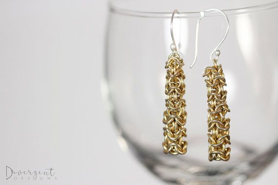 """Solid brass rings, handwoven together to form graduated brass towers with sterling silver ear wires.  Length: 5cm/2""""  ** All my ear wires are made of sterling silver and are nickel free."""
