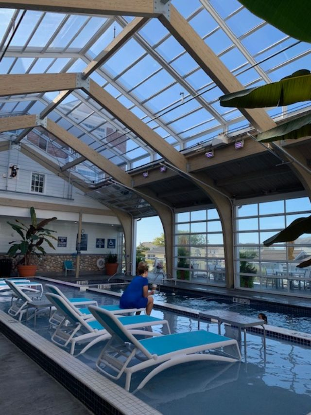 Hotel Lbi Retractable Skylight Manufactured By Roll A Cover Glass Pool Beautiful Pools Skylight