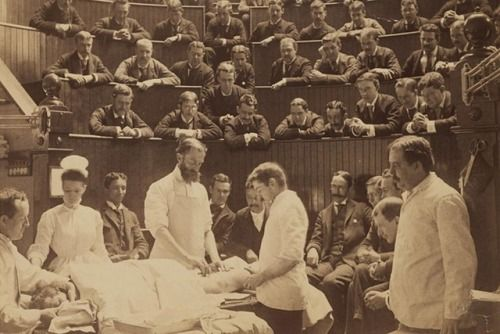 An operation takes place in the Boston City Hospital operating theater during the 1890s. Surgery as performance was common in the 19th century, and may surgeons of the time made their surgeries as compelling as possible for their audiences, complete with narration. This type of atmosphere became less popular after World War I, as more effective anesthetic (taking away the spectacle of a patient in pain) and slower, more meticulous surgery (pushing the limits of spectators' attention spans)…