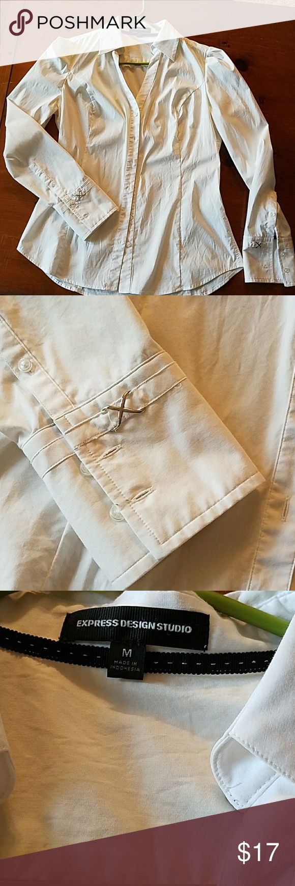 Essential express button down shirt White essential express shirt with cufflink detail. Slight pleats at the shoulder give this a feminine edge. Express Tops Button Down Shirts