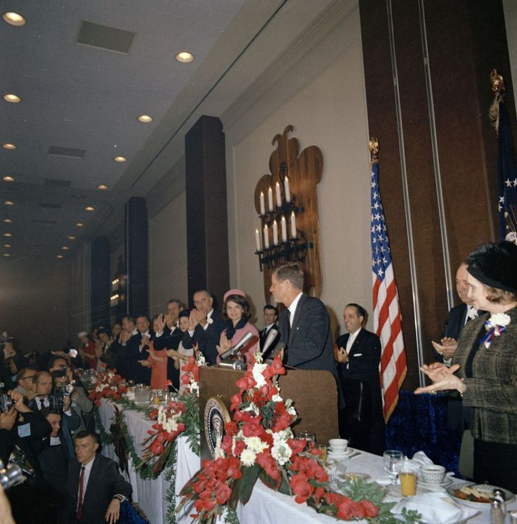 """The head table at the Fort Worth Chamber of Commerce Breakfast, Hotel Texas, Fort Worth, Texas. (including, L-R): Nellie Connally, Governor John Connally, Lady Bird Johnson, Vice President Lyndon B. Johnson, First Lady Jacqueline Kennedy and President John F. Kennedy behind the lectern. 22 November 1963. Credit:""""Cecil Stoughton. White House Photographs. John. F. Kennedy Presidential Library and Museum, Boston."""" Please credit """"Cecil Stoughton. White House Photographs. John F. Kennedy…"""