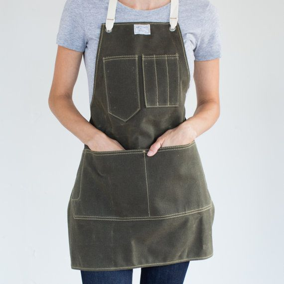 A unisex apron with a bit of heft. Designed for people who make and maintain things, it will stand the test of time.  Multiple tool pockets • Double needle stitched pockets with bartacks  Sizing (Measure over clothing)  Small: 27.5 W ✕ 26 L; fits 22 to 60 hip Medium: 29 W ✕ 29.5 L; fits 29 to 60 hip Large: 31.5W ✕ 31.5 L; fits 36 to 68 hip  Materials  Waxed Canvas, Duck Canvas, or Cone Denim Aged brass grommets with leather washers (vegan washers available by request) Shuttle loomed taffeta…