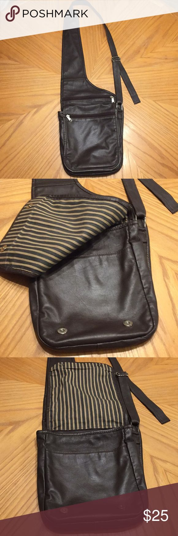 Crossbody Genuine dark brown leather quality crossbody. Purchased in Colombia South America. Has 5 openings for storage and long adjustable strap.   GUC has 2 minor blemishes as seen in pic and a hardly noticeable pen mark Bags Crossbody Bags