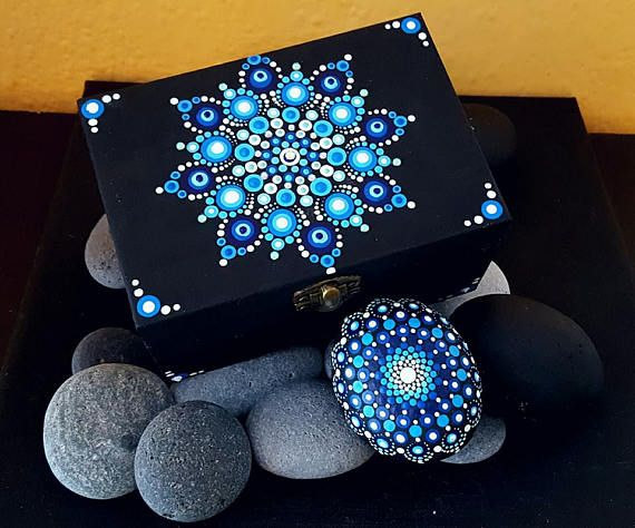My Mandala Jewellery Boxes are hand painted with Swarovski elements and protected with two coats of matt varnish.They are not suitable for outdoor use however. The smooth surface of thesejewellery boxes is the perfect surface to paint on and I can think of no better subject than beautiful, colorful mandalas.They are ALL one of a kind. International shipping available.You will receive the exact item in the photograph. Thank you for stopping by BarbaraMandalaTFSs Canvas-Clocks and Jewellery…