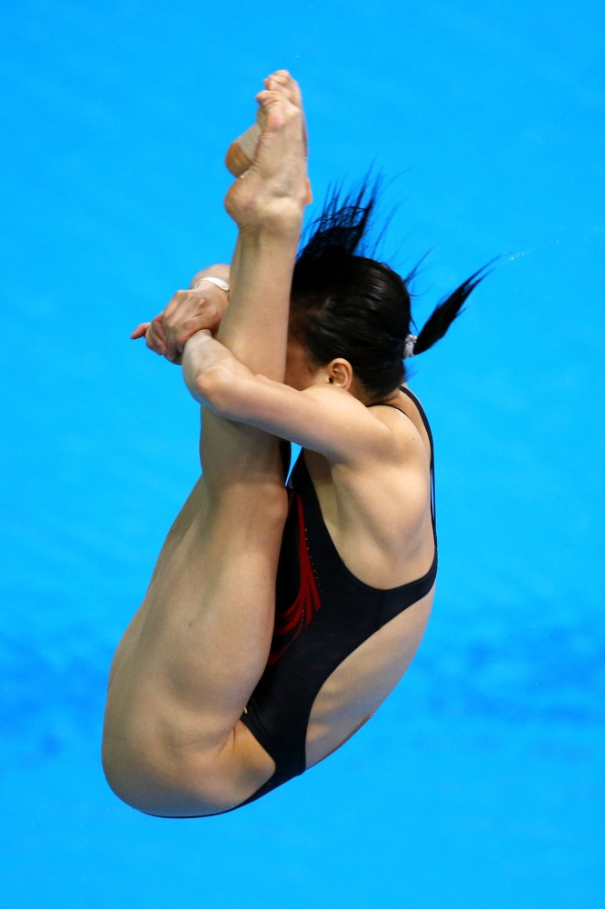 Minxia Wu of China competes in the Women's 3m Springboard Diving Preliminary Round on Day 7 of the London 2012 Olympic Games at the Aquatics Centre on August 3, 2012 in London, England.