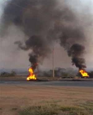 Chief Kekana denies getting Hammanskraal eviction order.  Fires during protests burn in Hammanskraal (Karabo Ngoepe, News24)