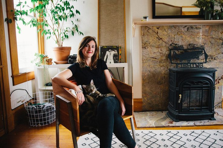 """To be honest, the furniture was so ugly when I moved in with my husband. He knew it too, so he didn't mind me doing a refresh. We both like spaces that feel a little modern, a little outdoorsy and very comfortable. It was sweet to redecorate and make it feel like ours.""—Emily in San Francisco, (she made that chair!), saving ideas for DIY decor on Pinterest"