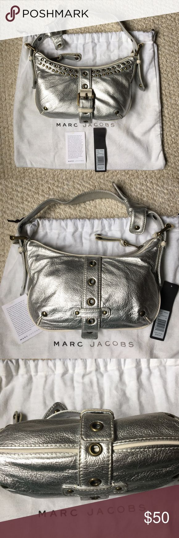 """Marc Jacobs Metallic Silver Shoulder Bag Marc Jacobs small metallic silver shoulder bag with brass hardware. Comes with original price tag, care card, tissue stuffing and dust bag. Style #M353041.  Measurements:  11"""" W x 5.5"""" H x 2.5"""" D. Strap:  19"""" L, 9"""" drop. Zip closure.  Printed lining with 1 slip pocket.  Hardly used and in very good condition. Marc Jacobs Bags Shoulder Bags"""
