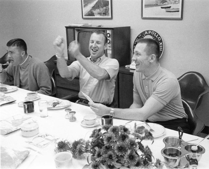 Fred Haise (left), Jim Lovell, and Jack Swigert, at breakfast on launch day. Photo filed 11 April 1970. Scan by Ed Hengeveld. NASA