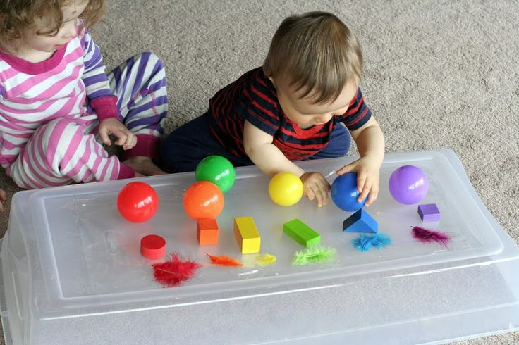 Tape down contact paper and give babies different colored objects to grasp and unstick