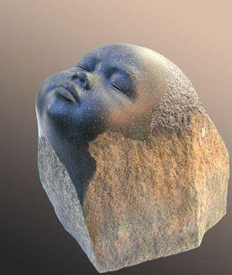 Baby Boeddha gemaakt van een basaltblok. Sculptor: Georg Schmerholz