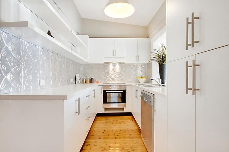 Beautiful kitchen with pressed metal splashback. http://www.restorationonline.com.au/pressed-tin/pressed-tin-wall-ceiling-panels