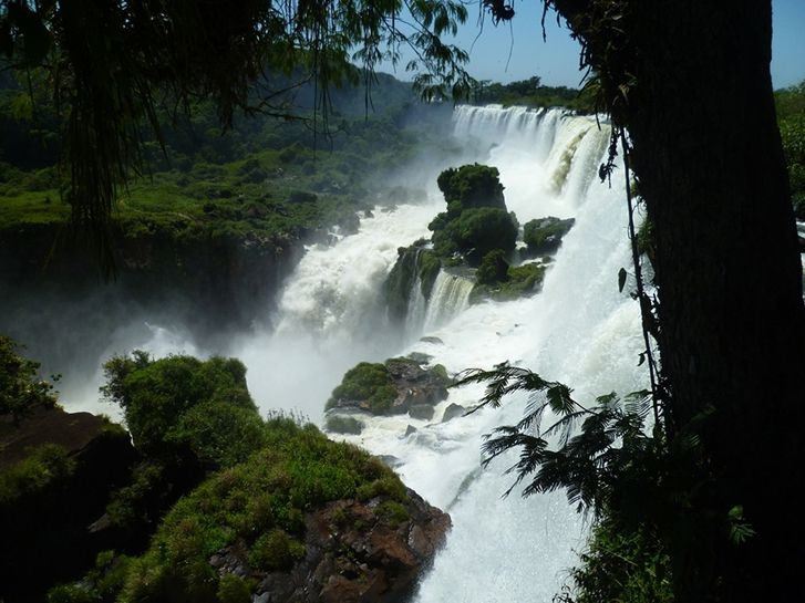 This photo was taken at the top of the falls in Argentina, but below the falls the Iguazu river marks the border between Argentina and Brazil. The falls are shared by two UNESCO World Heritage Sites, the Iguazu National Park of Argentina and the Iguacu National Park of Brazil.