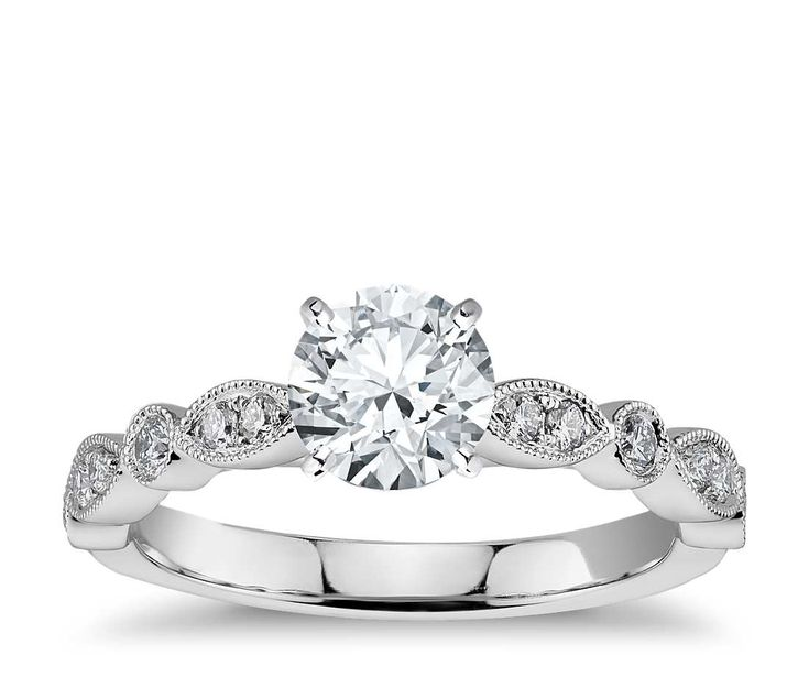 Vintage-inpired, this diamond engagement ring is crafted in white gold and  features petite diamonds set in a marquise and dot pattern with milgrain  edges to ...