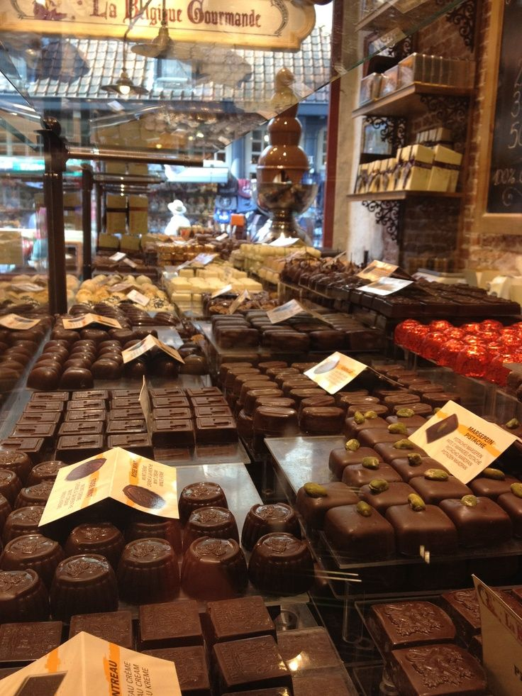 The pretty city of Bruges. As well as quaint canals and charming historic streets, they're pretty good at chocolate, too. (Photo via Anna Johnstone on Pinterest)