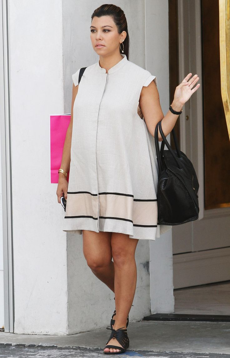 Kourtney Kardashian in a Cameo dress, Givenchy flats, Celine bag and Kardashian Kollection sunglasses.