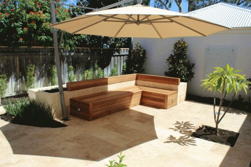 Residential Projects - Perth, Western Australia - DBM Landscapes. Feature courtyard. travertine paving and landscaping with timber seating and outdoor shade www.dbmlandscapes.com.au