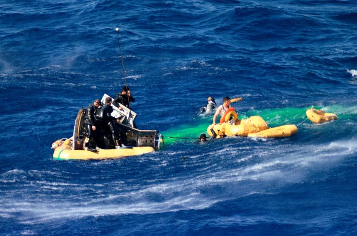 Gemini III pilot John Young waits in a life raft to be picked up by a helicopter during recovery operations following the successful three-orbit mission. Young and command pilot Gus Grissom were flown by helicopter to the nearby recovery aircraft carrier, the USS Intrepid.  Credits: NASA