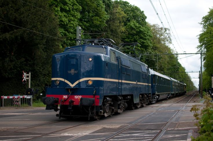 """NS 1202.  the Netherlands. From the year 1951, the E-locomotive series 1200, developed by the American firm Baldwin / Westinghouse were manufactured for the Dutch railways by """"Werkspoor 'in Amsterdam. With 3000 hp got this bad boy up to a maximum speed of 135 kilometers per hour. This locomotive was both passenger trains and freight traffic deployed."""