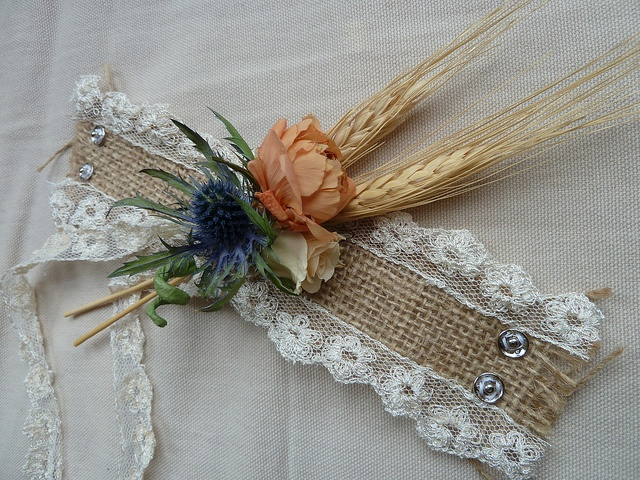 Lace and Burlap Corsage. Gorgeous, but I feel like it would be even itchier than corsages already are.