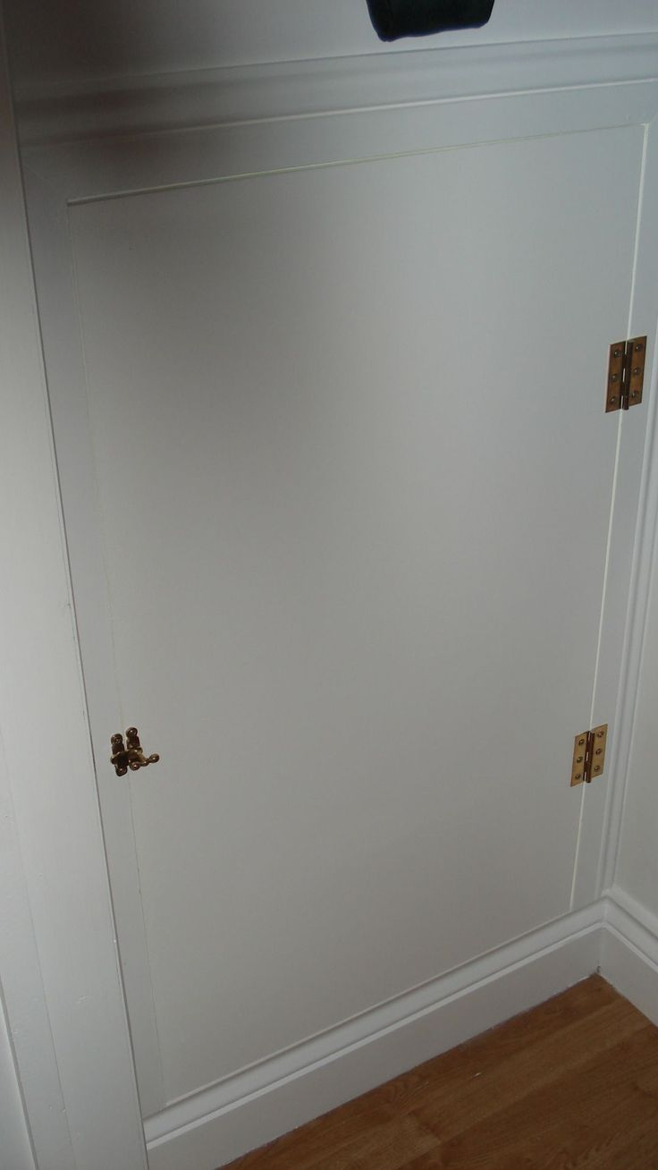 15. Cat Cave servants entrance. Door in MDF and by putting the skirting on the wrong way round (deepest width closest to the opening) it created the thickest and flattest surface for the hinges to mount on