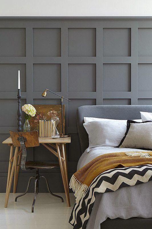 En snygg panel från vägg till vägg kan fungera som sänggavel.